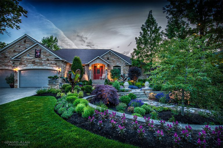 meticulous front landscape design featuring purple flowers and various shrubs