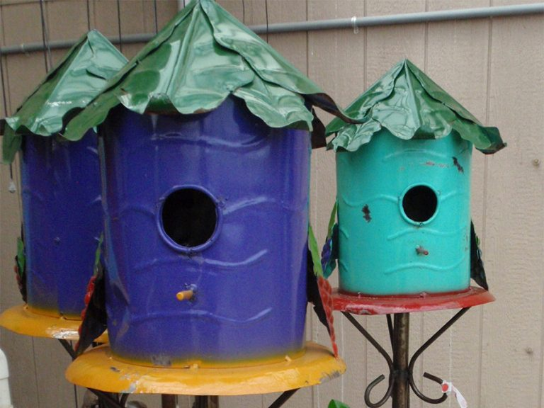 blue and teal metal birdhouses