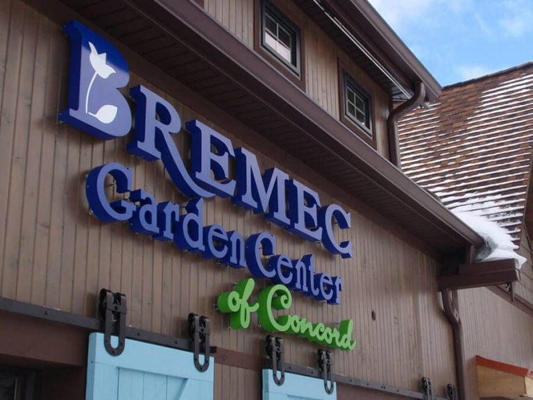 exterior view of Bremec Garden Center of Concord blue and green sign