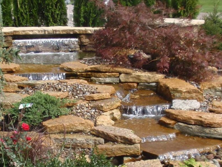 garden waterfall with natural stones
