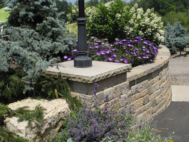 natural stone wall enclosing landscaping