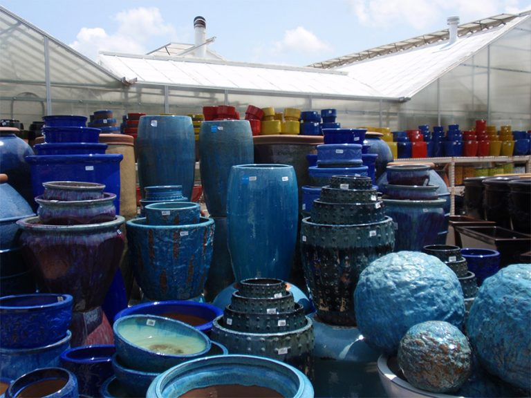 assorted large blue garden containers