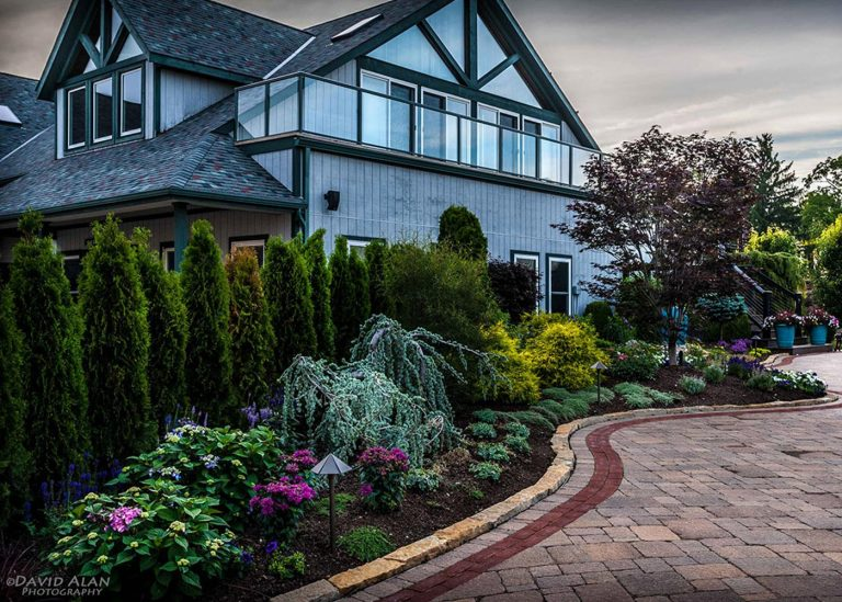 landscaping along a natural stone paved walkway