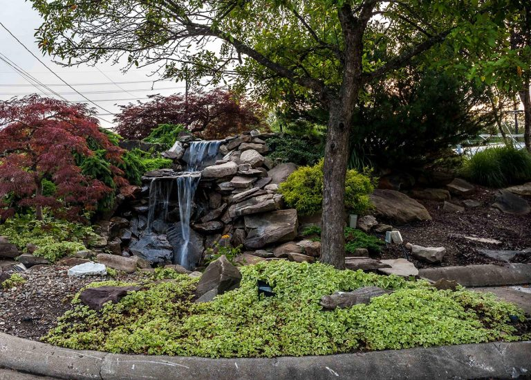 outdoor waterfall feature designed by The Bremec Group
