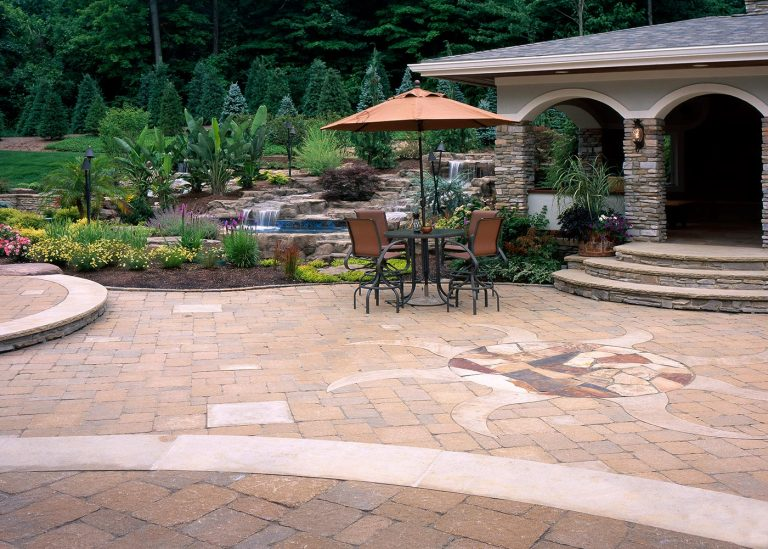 outdoor paved patio with intricate sun design by The Bremec Group