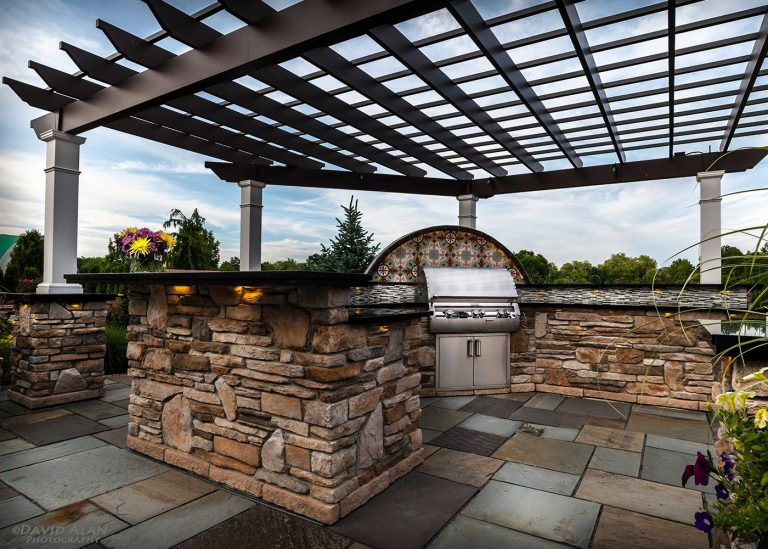 outdoor kitchen with stone bar designed by The Bremec Group
