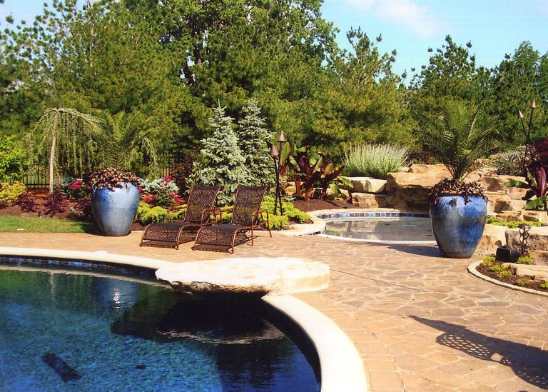 pool deck with large potted plants designed by The Bremec Group