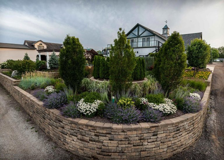 natural stone wall and landscaping by The Bremec Group
