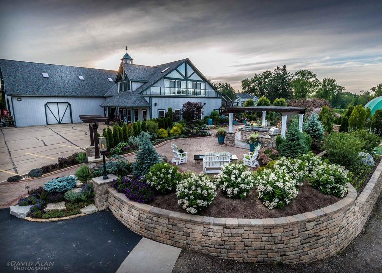 faraway view of outdoor landscape design and stone wall designed by The Bremec Group